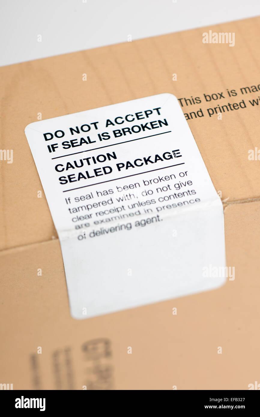 Non accettare se la guarnizione si è rotta e etichetta attenzione confezione sigillata Immagini Stock