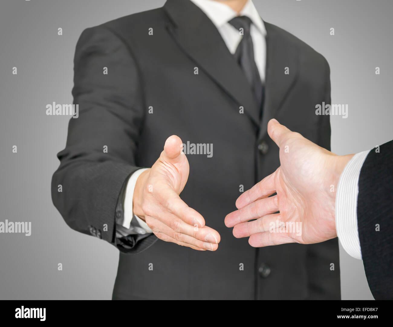 Business handshake, il punto di vista della composizione Immagini Stock