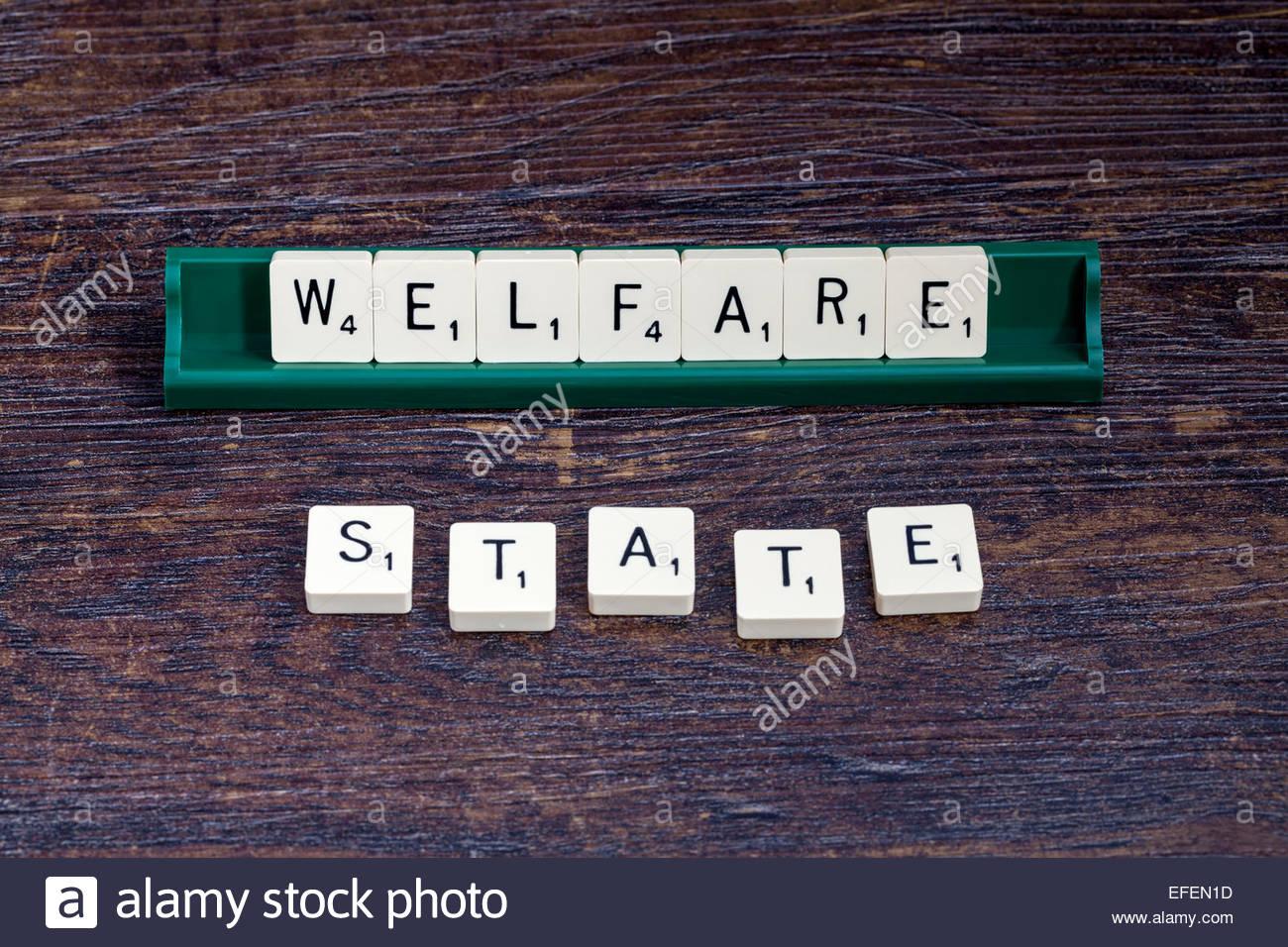 Stato sociale enunciato con lettere di scrabble Immagini Stock