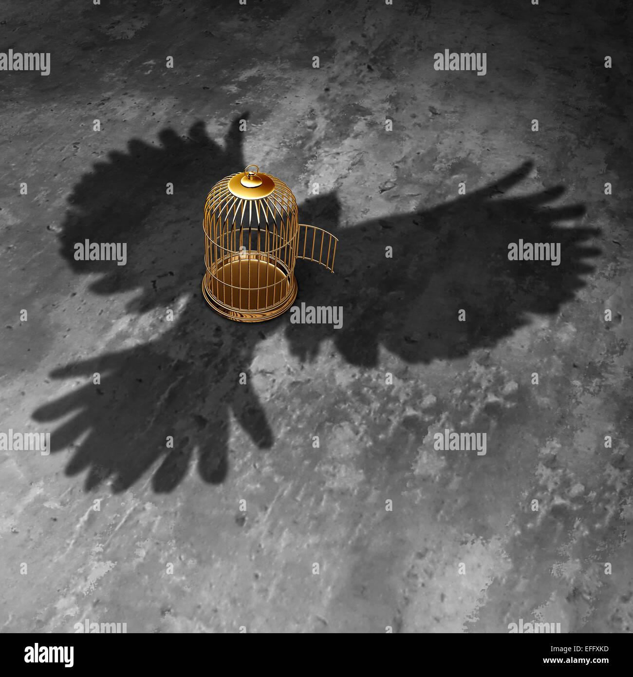 Gabbia concetto di libertà come un open birdcage con un uccello gigante gettato ombra volare al di sopra con Immagini Stock