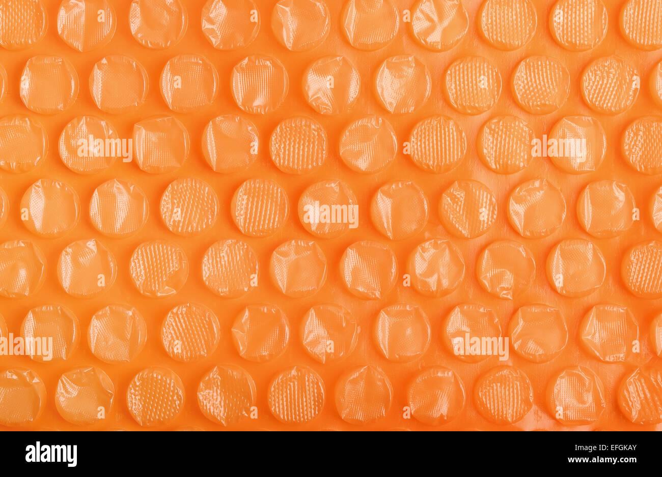In plastica arancione Bubble wrap sfondo Immagini Stock