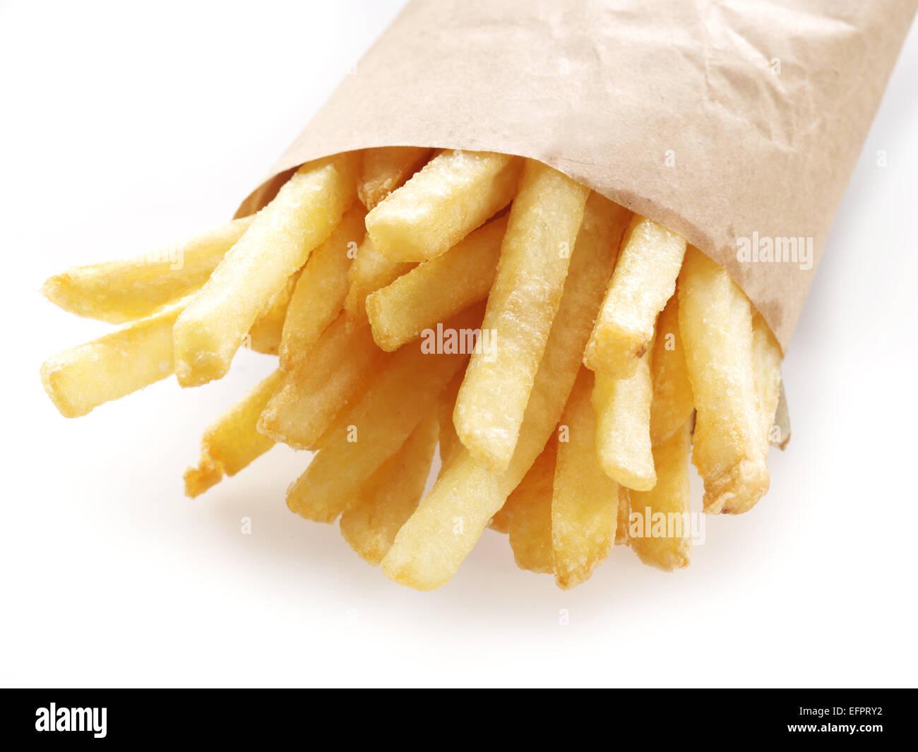- Patate fritte su uno sfondo bianco. Immagini Stock