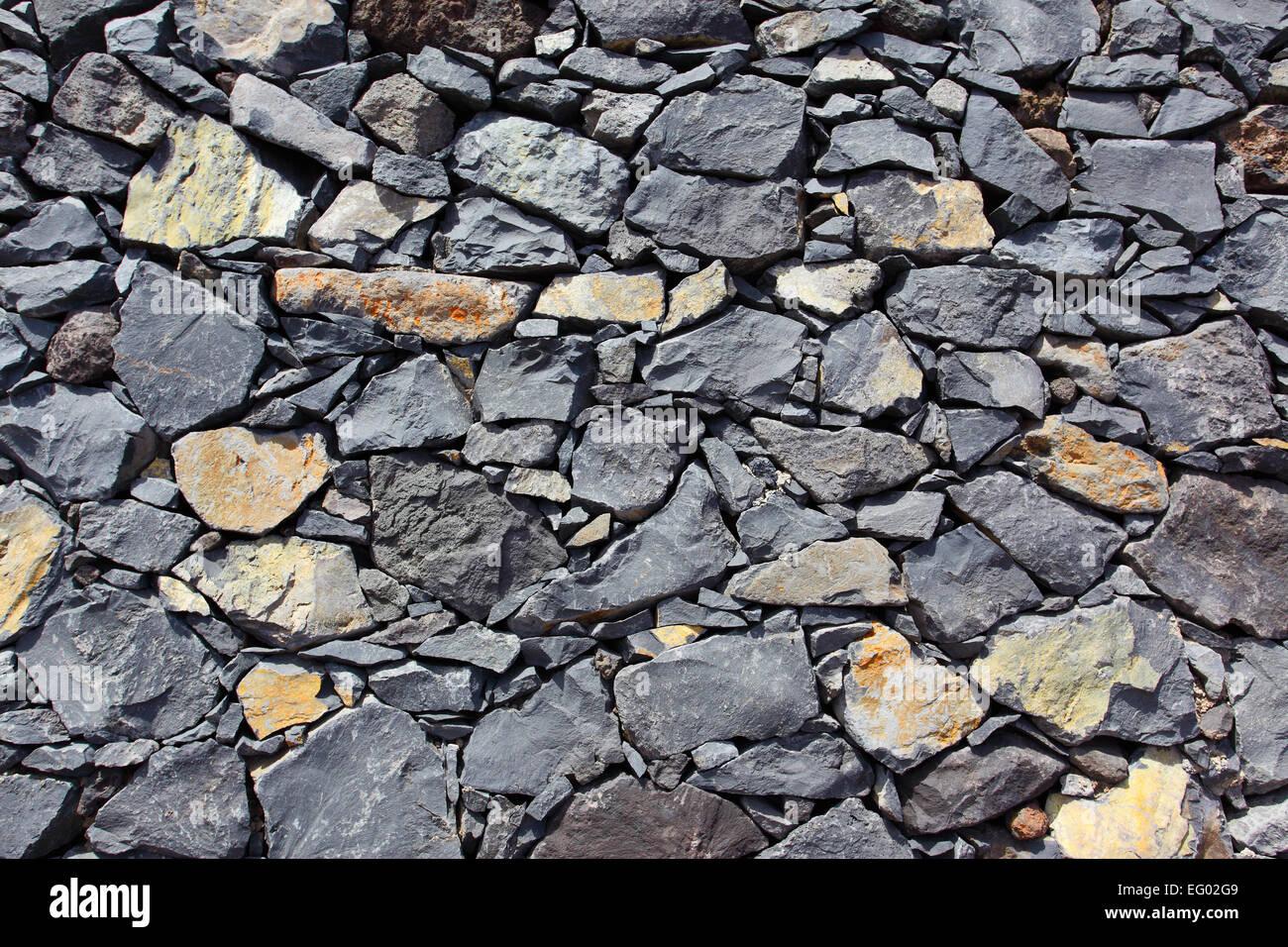 Muro Fatto In Pietra la texture di un muro fatto di pietra vulcanica foto