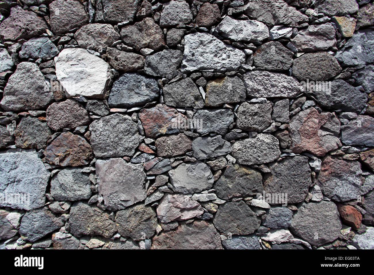 Muro Fatto In Pietra la texture di un muro fatto di pietra vulcanica foto stock