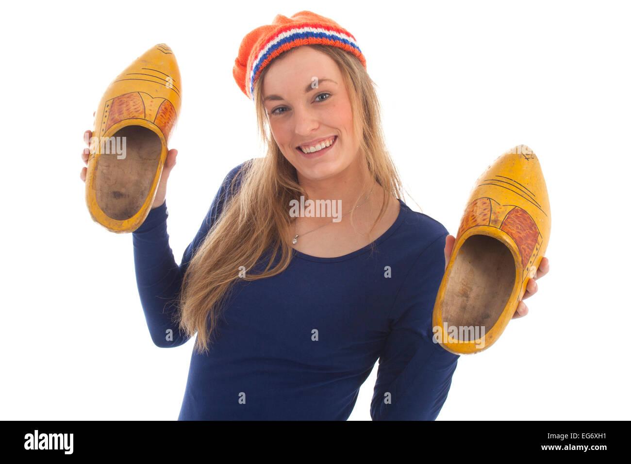 Carino hollands ragazza con zoccoli isolato su bianco Immagini Stock