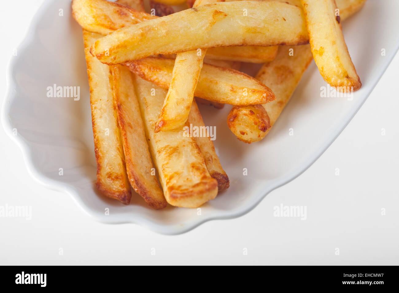 Le patatine fritte in un piatto tipico Immagini Stock
