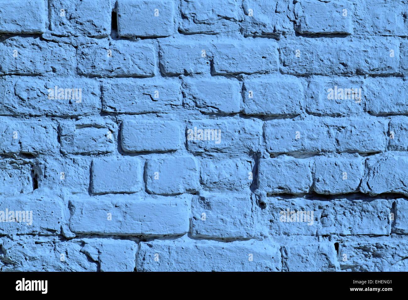 Il dipinto di blu un muro di mattoni Foto Stock