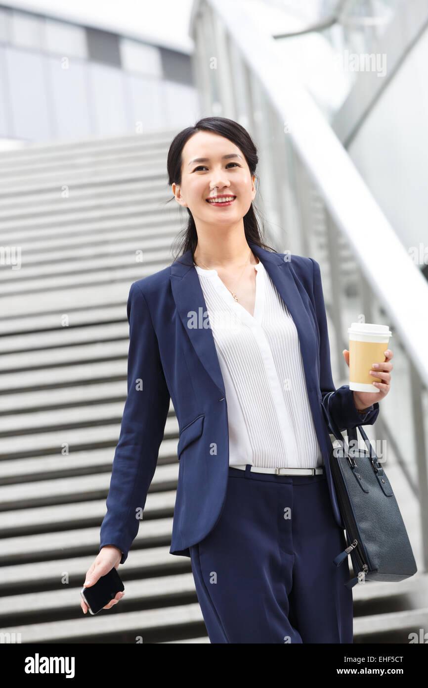 Business orientali le donne lavorano in anticipo Immagini Stock