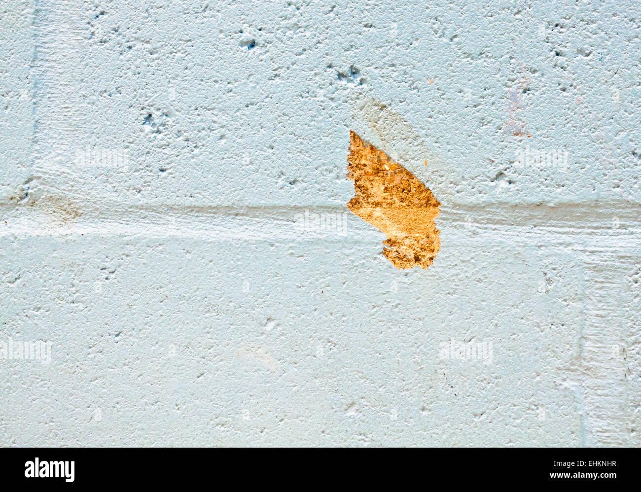 Un piccolo difetto di un muro di mattoni Immagini Stock