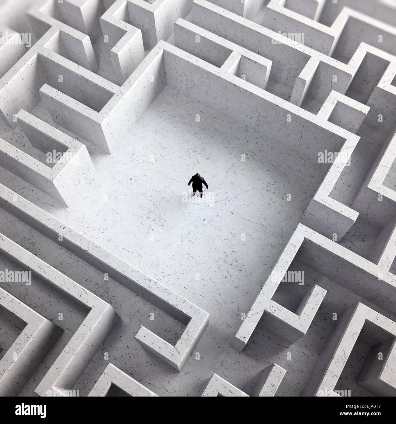 Piccolo uomo dentro un infinito labirinto Immagini Stock