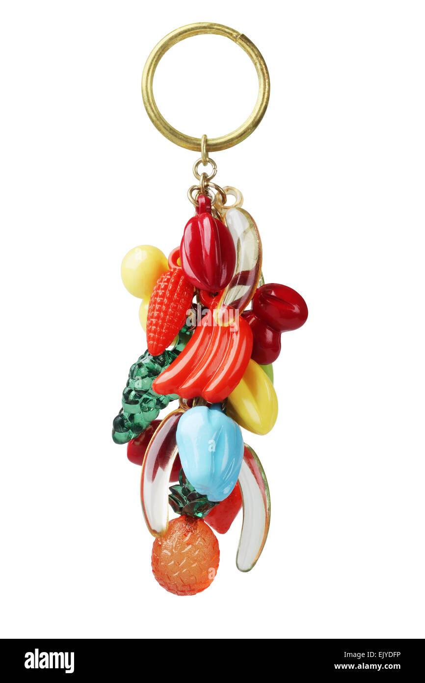 Portachiavi in plastica con frutti gingillo su sfondo bianco Immagini Stock