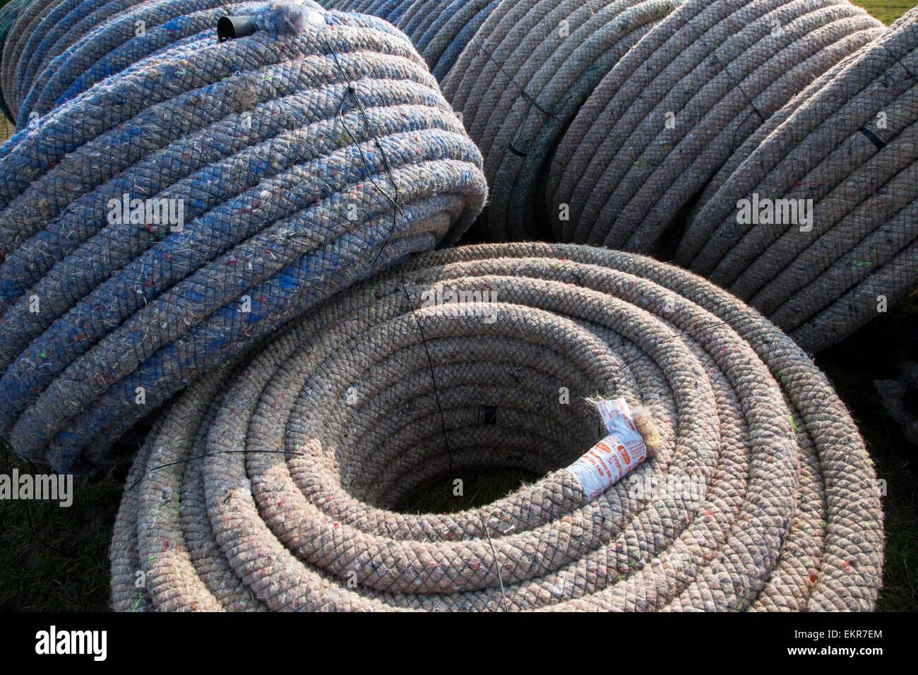 Tubi di drenaggio per il drenaggio scavatrincee / tile aratro Immagini Stock
