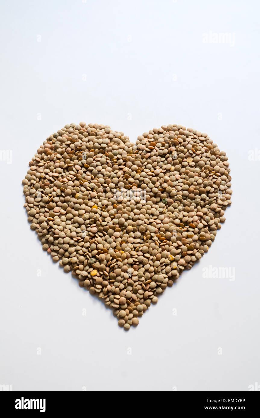 Concetto: lenticchie, buono per la salute del cuore. Immagini Stock