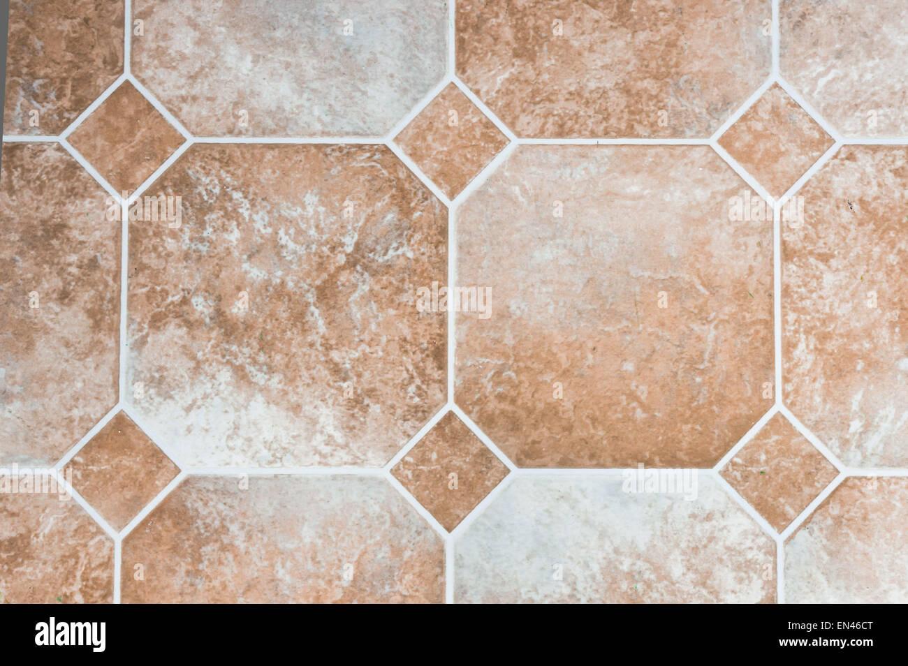 Color beige piastrelle di vinile su un pavimento di cucina foto