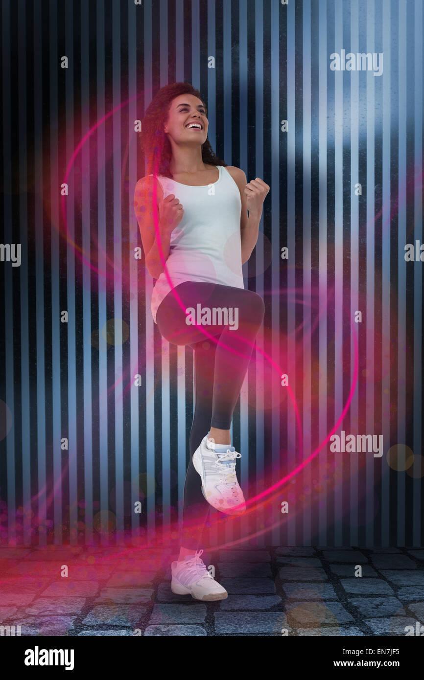 Immagine composita di montare la donna facendo esercizio aerobico Immagini Stock