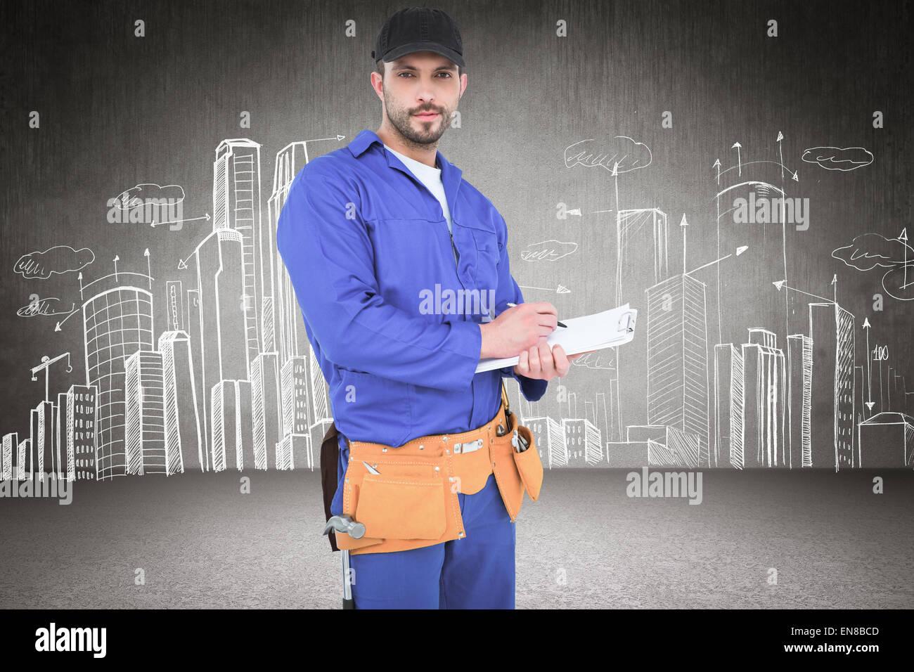 Immagine composita di tuttofare in tuta blu iscritto negli appunti Immagini Stock