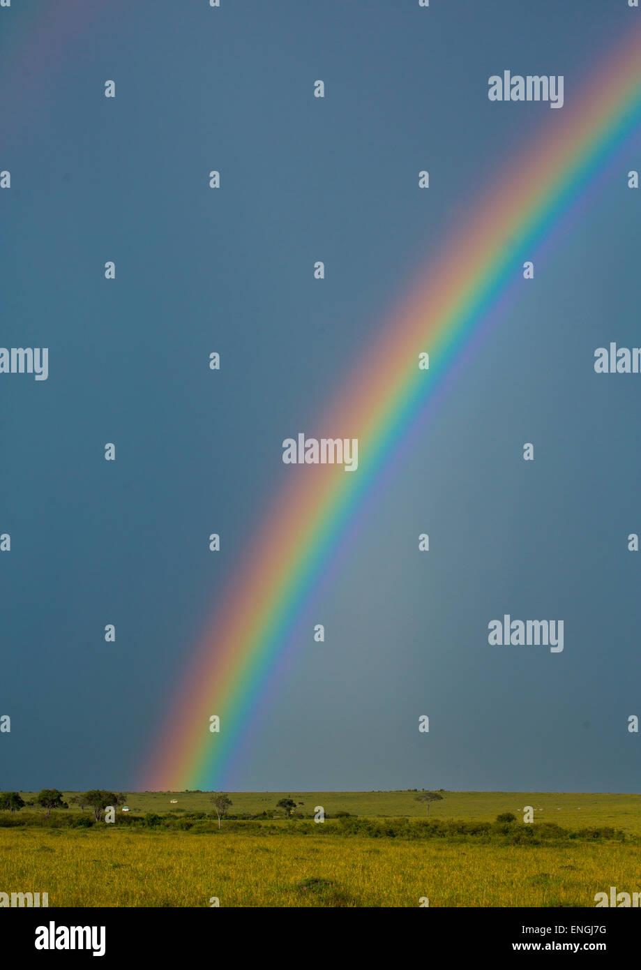 Rainbow dopo il temporale, Rift Valley Provincia, il Masai Mara, Kenya Immagini Stock