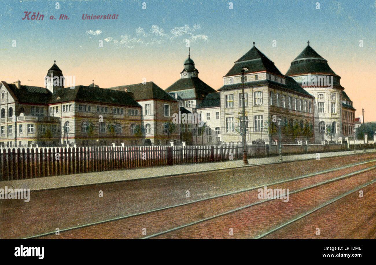 Università di Colonia svolta del xx secolo vista della strada e con le linee di tram in primo piano. Köln. Immagini Stock