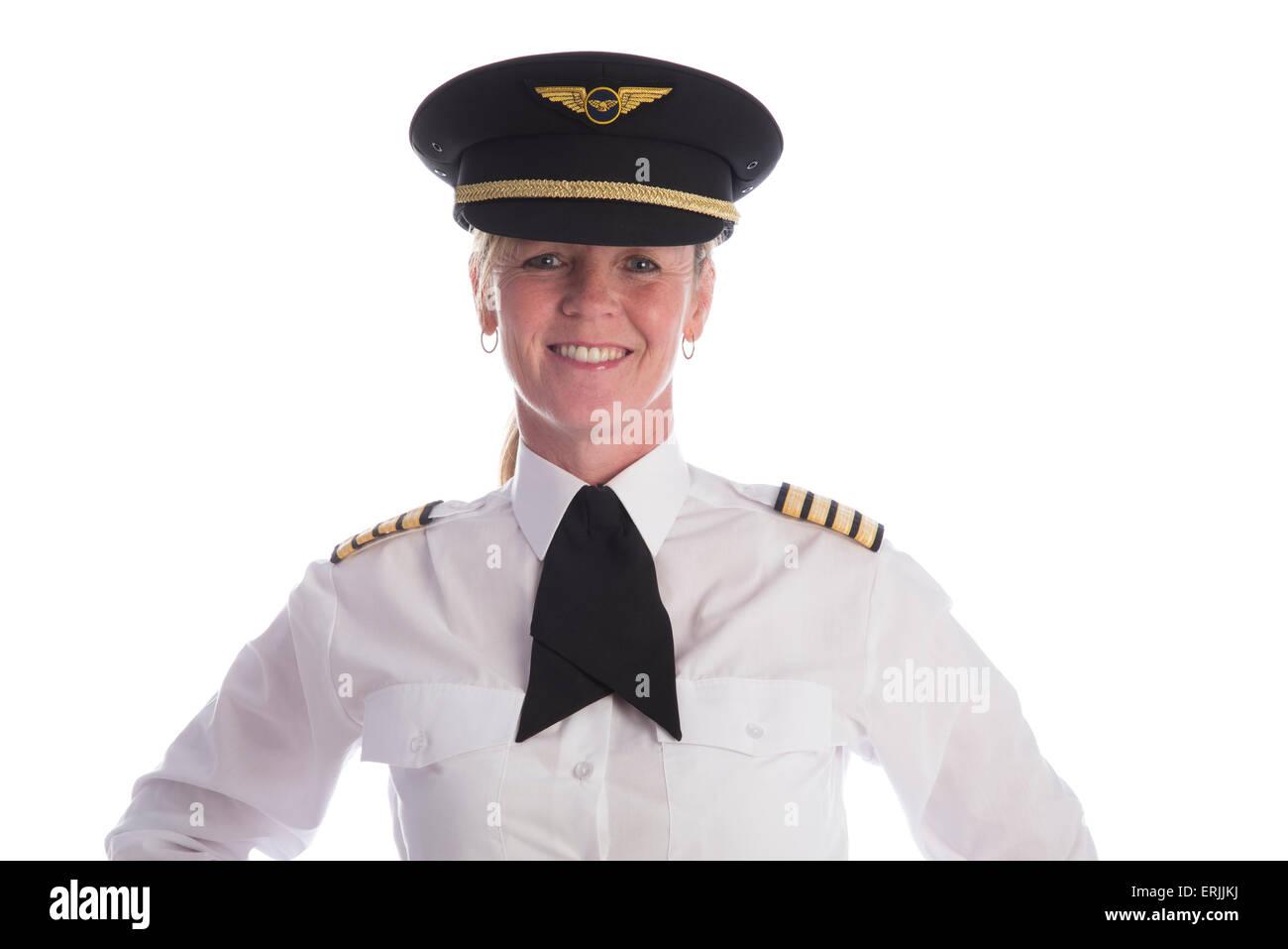 Femmina pilota senior in uniforme e che indossa il suo cappello e un cravat  Immagini Stock 6e8d40fae168