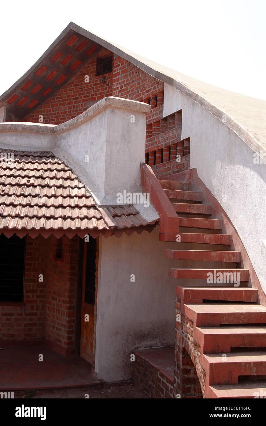 Scale di un muro di mattoni casa forma grafica della casa Immagini Stock