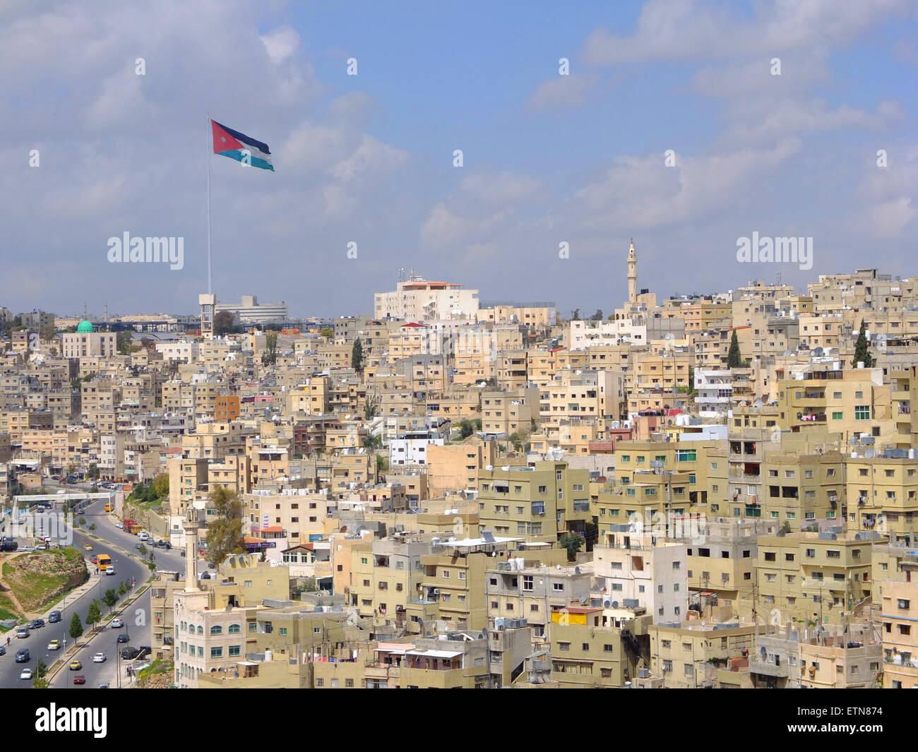 Bandiera di Amman e sullo skyline, Giordania Immagini Stock