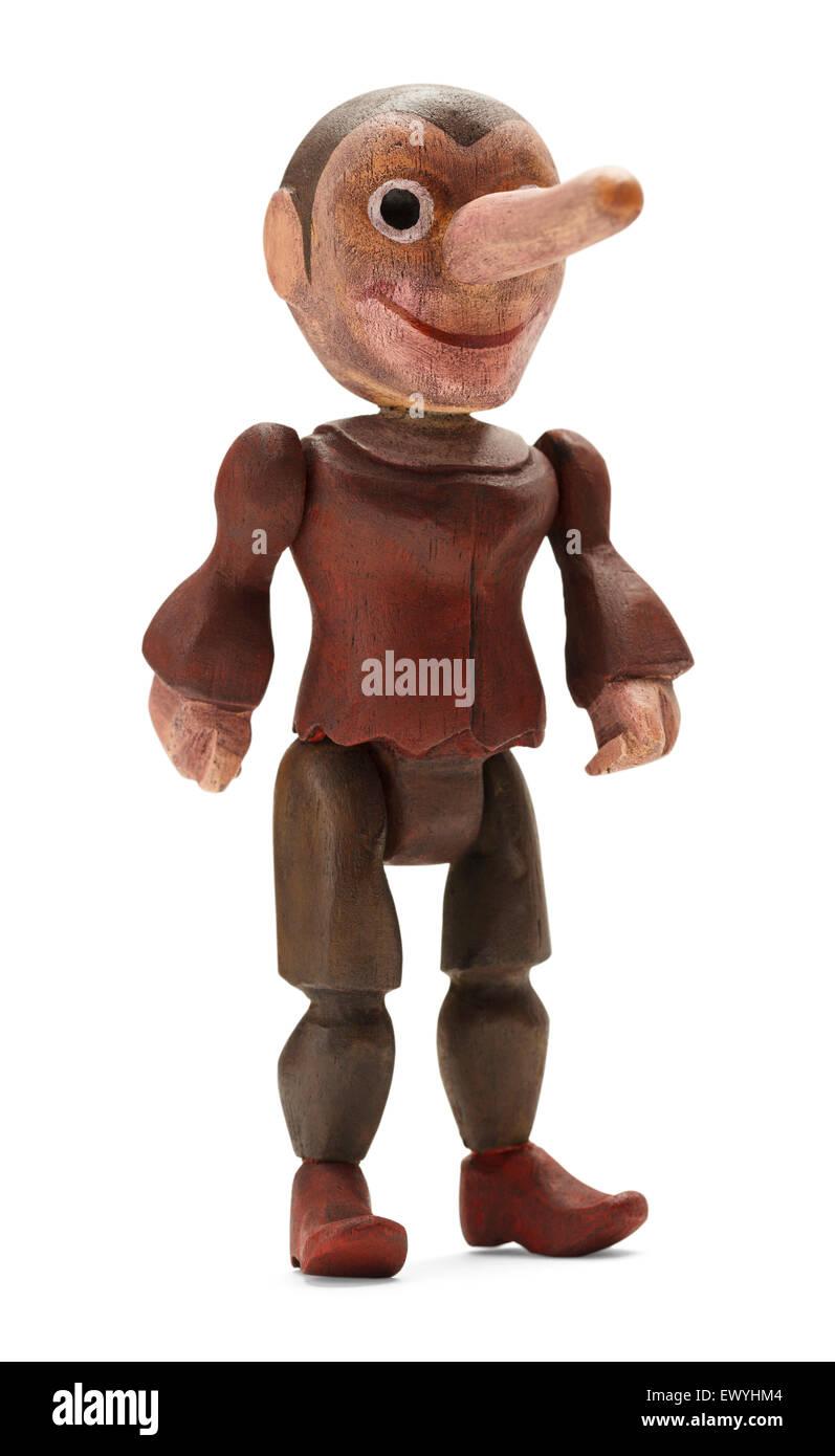 Pinocchio permanente Bambola di legno isolato su sfondo bianco. Immagini Stock