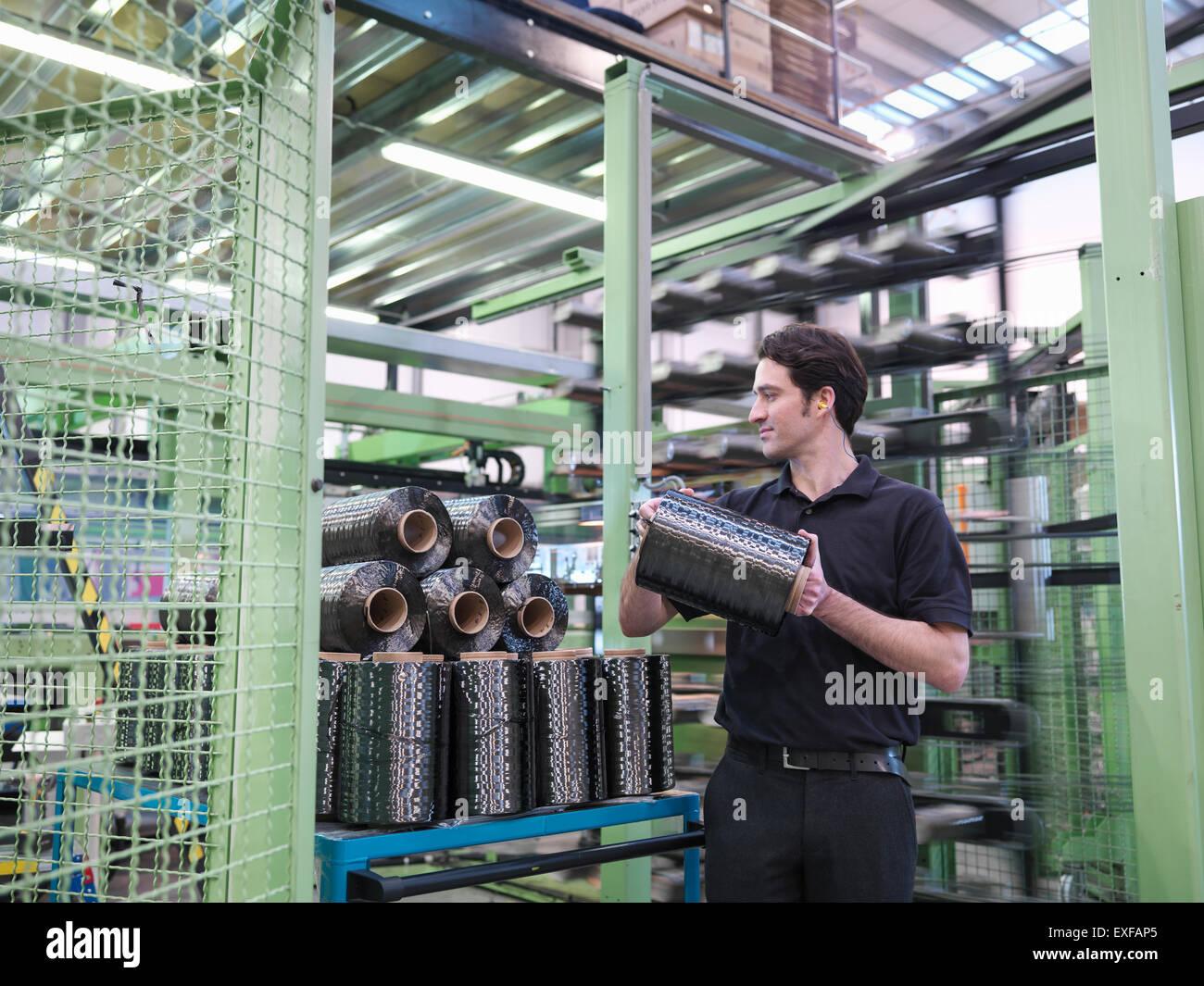 Lavoratore portante in fibra di carbonio filo in fibra di carbonio factory Immagini Stock