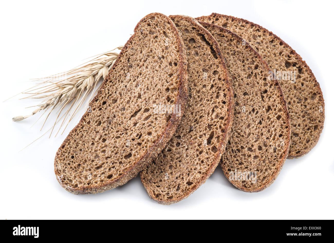 Le fette di pane su uno sfondo bianco. Immagini Stock