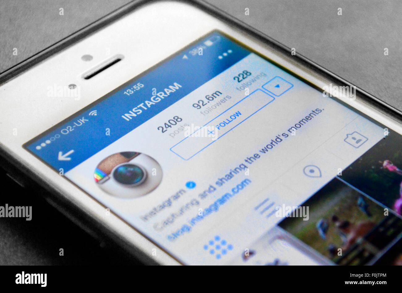 Instagram app su iphone segui Immagini Stock