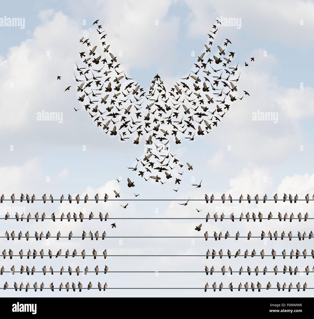 Organizzazione di successo il concetto di business come un gruppo di uccelli su un filo con un team volare lontano Immagini Stock