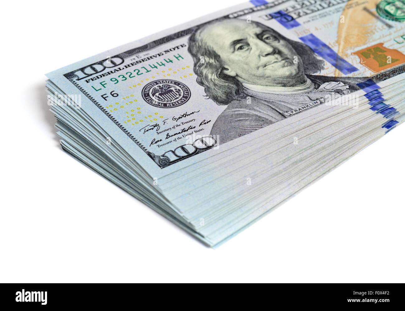 Pila di centinaia di dollari isolato su bianco Immagini Stock
