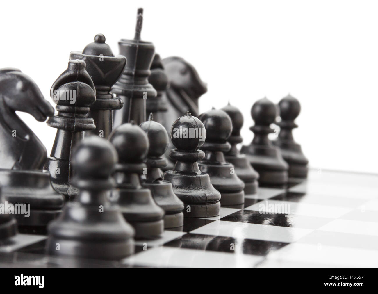 Nero a scacchi sulla scacchiera. Immagini Stock