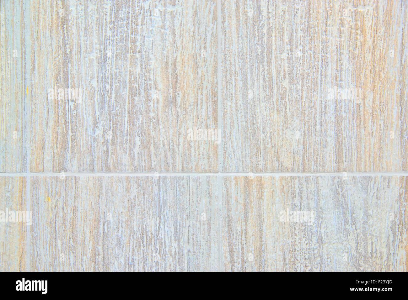 Il beige texture di sfondo piastrelle con malta cementizia foto