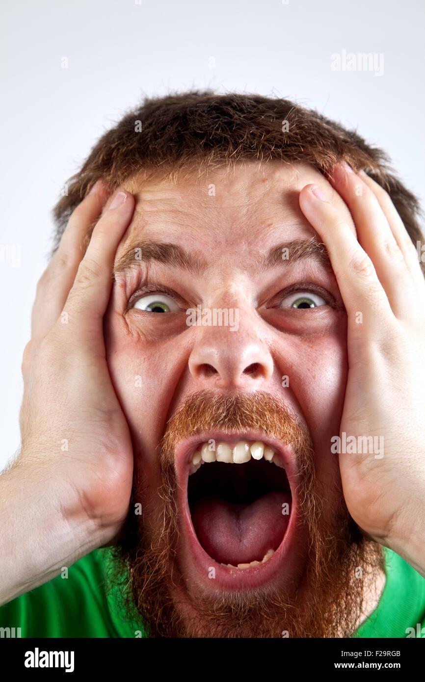 Win concetto - Scream di felice stupiti maschio Immagini Stock