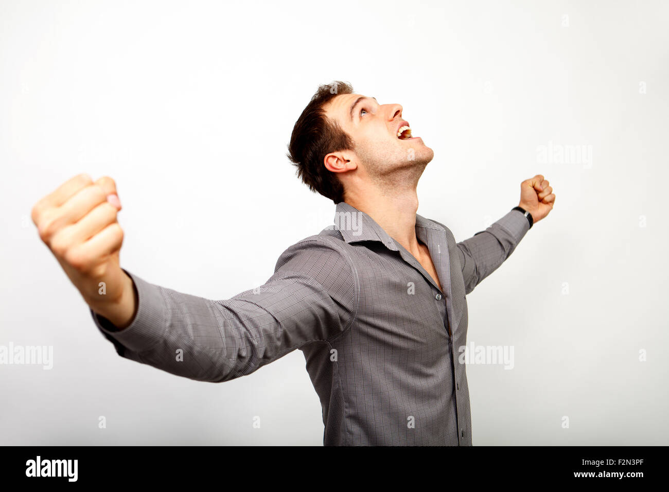 Emozionato uomo felice per la vittoria e il successo Immagini Stock