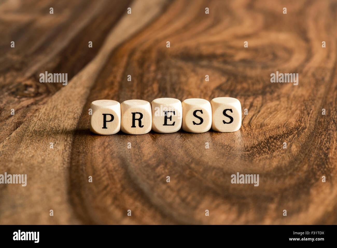 Premere parola sfondo su blocchi di legno Immagini Stock