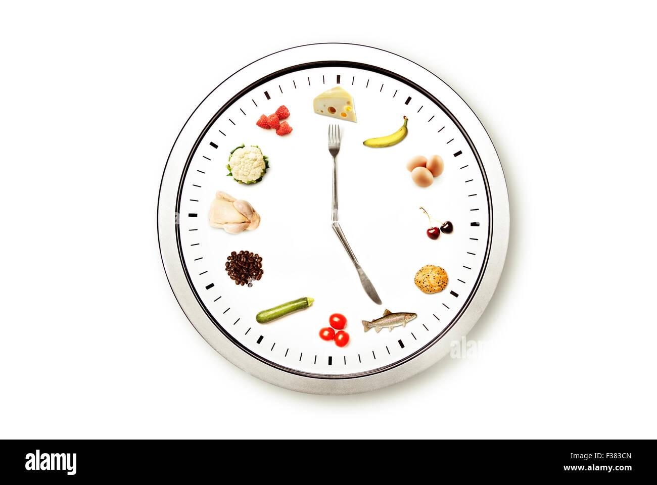 Tempo per il cibo, immagine concettuale per la dieta e la nutrizione Immagini Stock