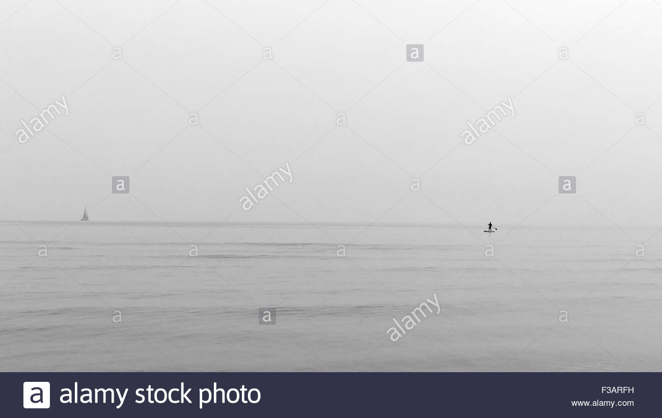 Uomini soli in mare Immagini Stock