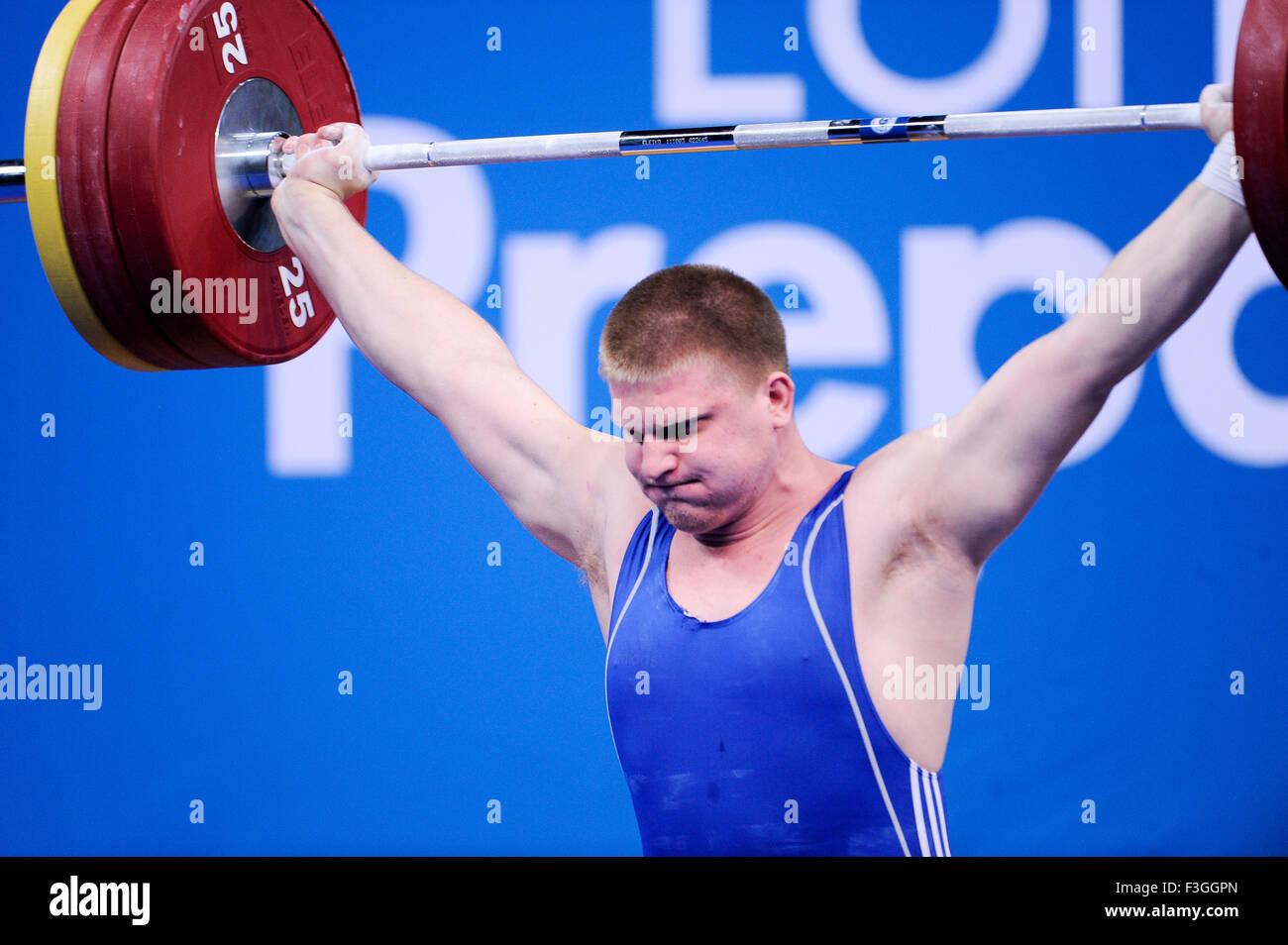 KAPLIN Dmityiy (KAZ) a strappo, il London prepara il sollevamento pesi olimpico Evento di prova, ExCel Arena, Londra, Immagini Stock