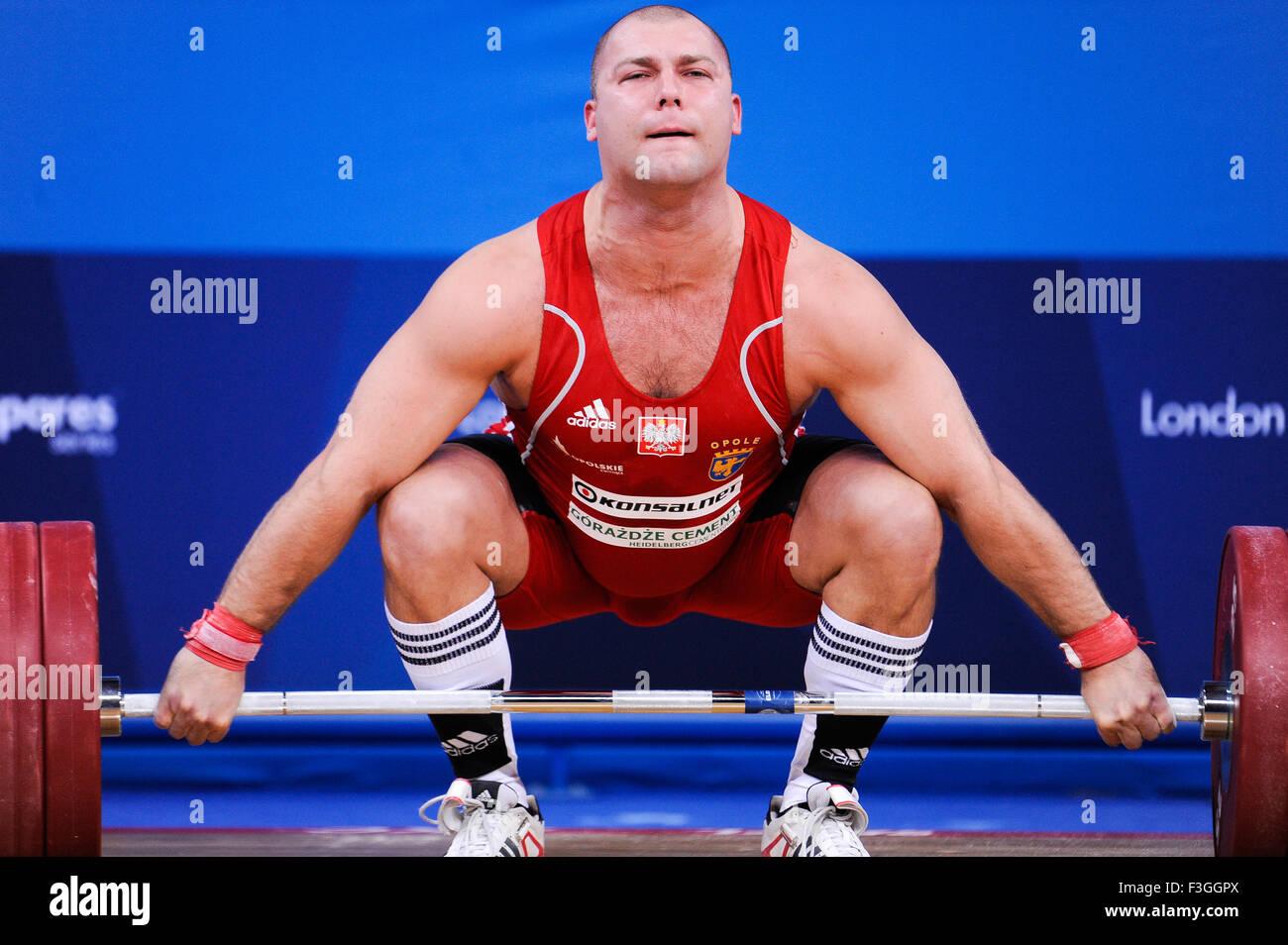 Bartlomiej BONK (POL) a strappo, il London prepara il sollevamento pesi olimpico Evento di prova, ExCel Arena, Londra, Immagini Stock