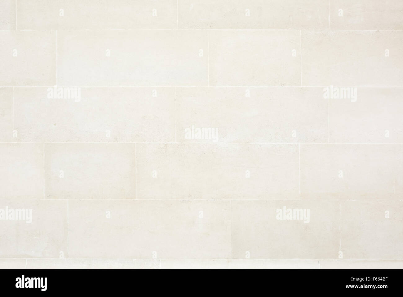 In piastrelle beige muro di pietra sfondo texture foto & immagine