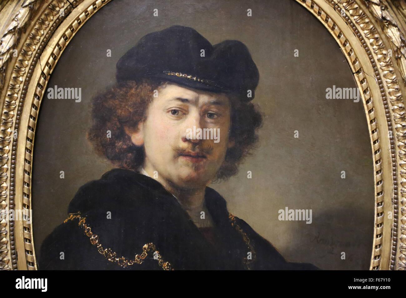 Rembrandt (1606-1669). Pittore olandese. Ritratto di auto che indossa un cappello da cuoco di colore rosso e oro, Immagini Stock