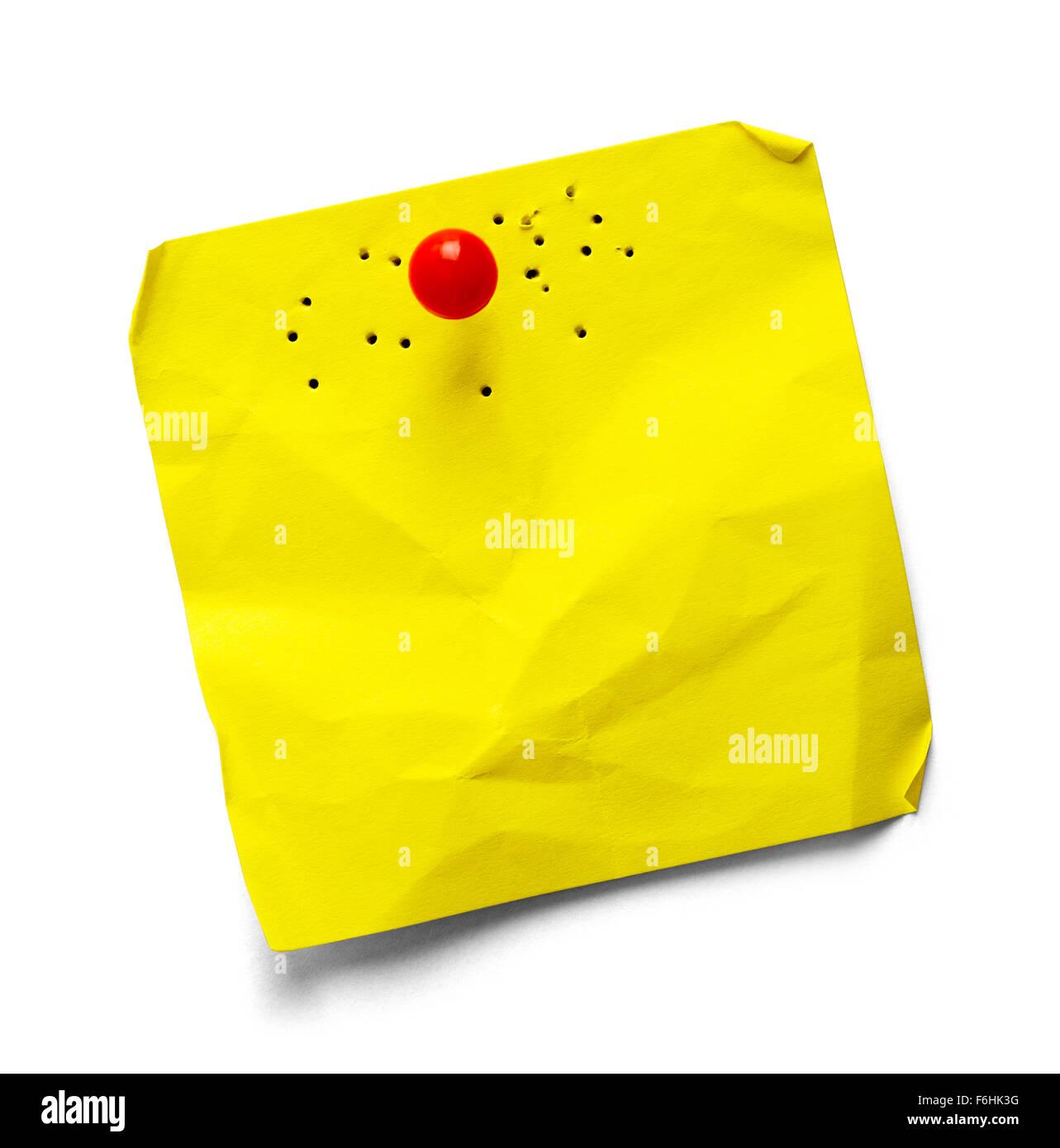 Bigliettino giallo con fori multipli isolati su uno sfondo bianco. Immagini Stock