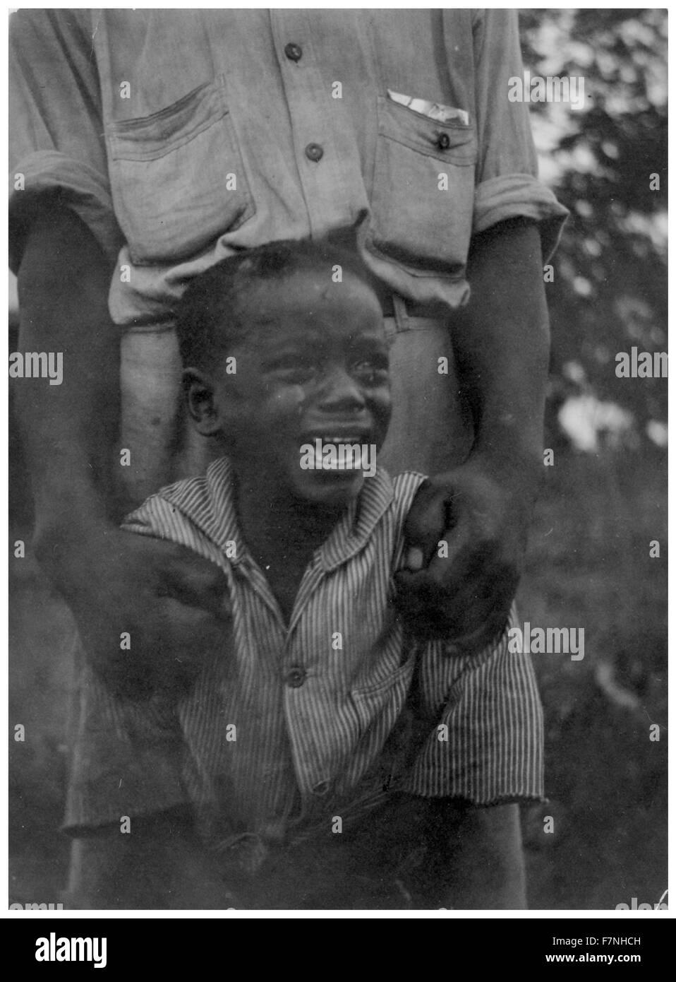 Giovane americano africano ragazzo. 1940 Immagini Stock