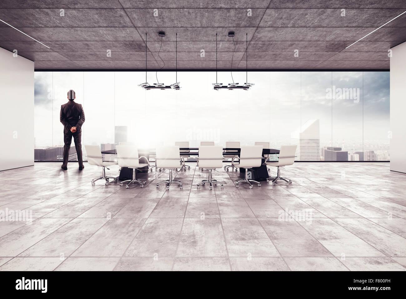 Imprenditore di successo in una sala riunioni Immagini Stock