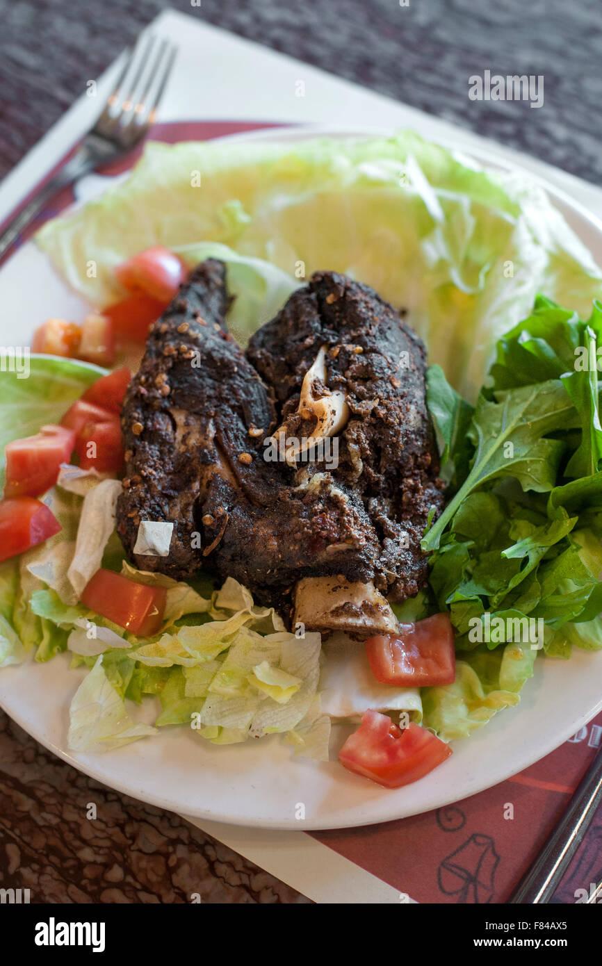 Agnello shewa, un tradizionale piatto Omani come servita dalla Al Maida ristorante in Muscat, la capitale del sultanato Immagini Stock