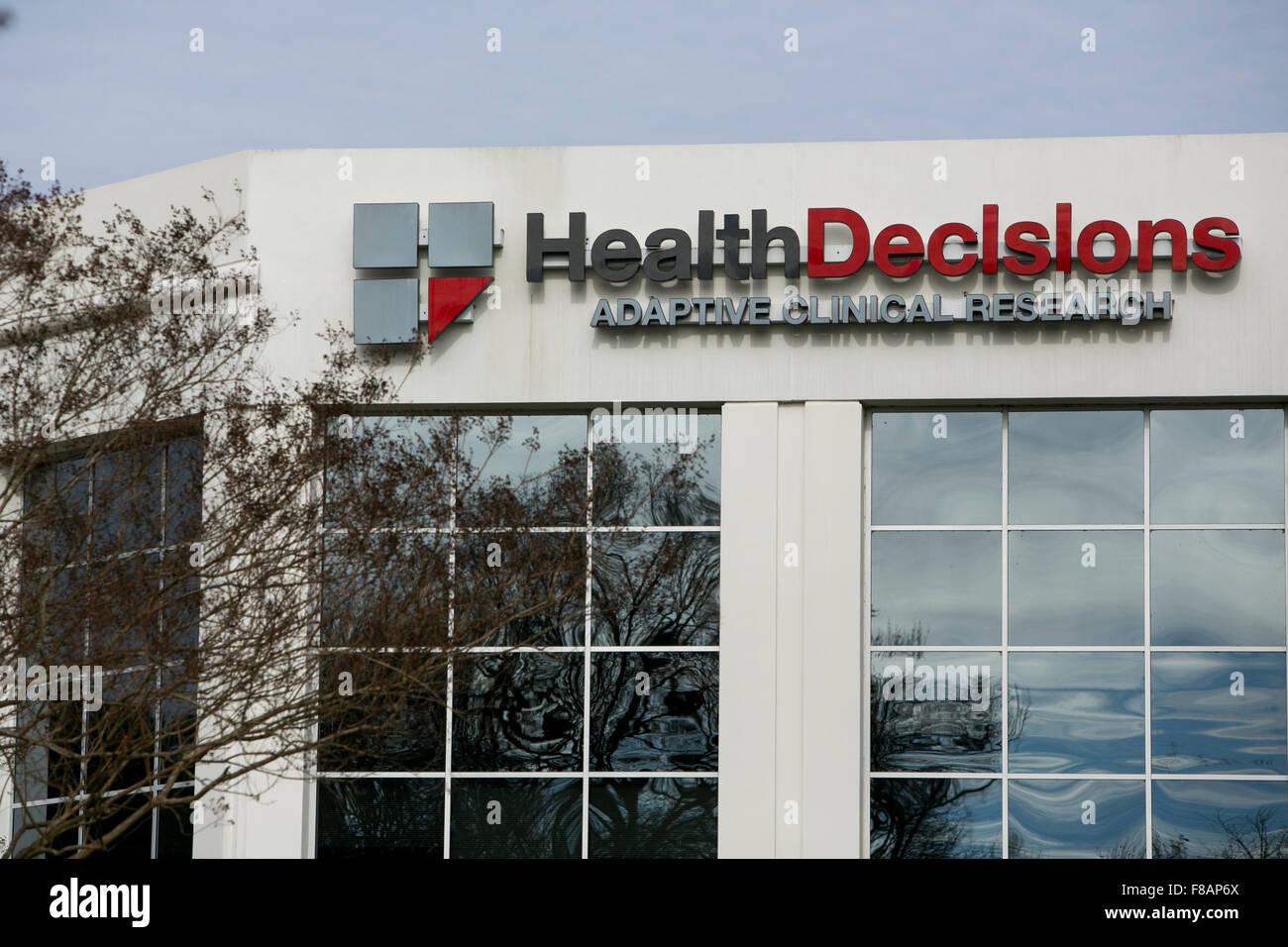 Un segno del logo al di fuori di una struttura occupata dalle decisioni di salute Inc., in Durham, North Carolina Foto Stock