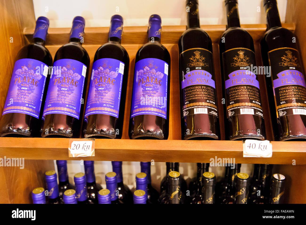 Scaffale per bottiglie di vino appeso in legno massello espositore