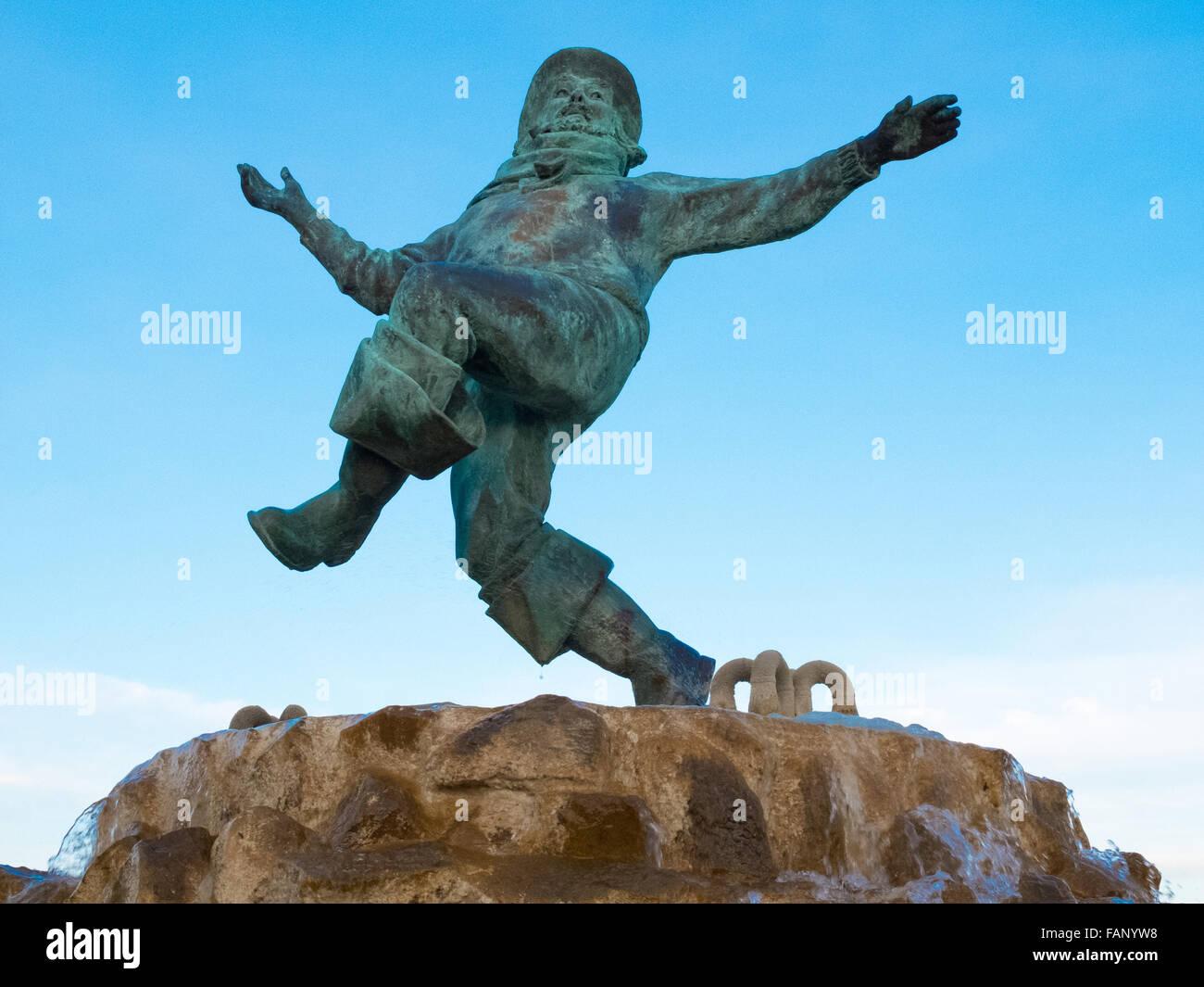 Il Jolly Fisherman statua in Compass Gardens,Tower Gardens vicino al fronte mare a Skegness. Immagini Stock