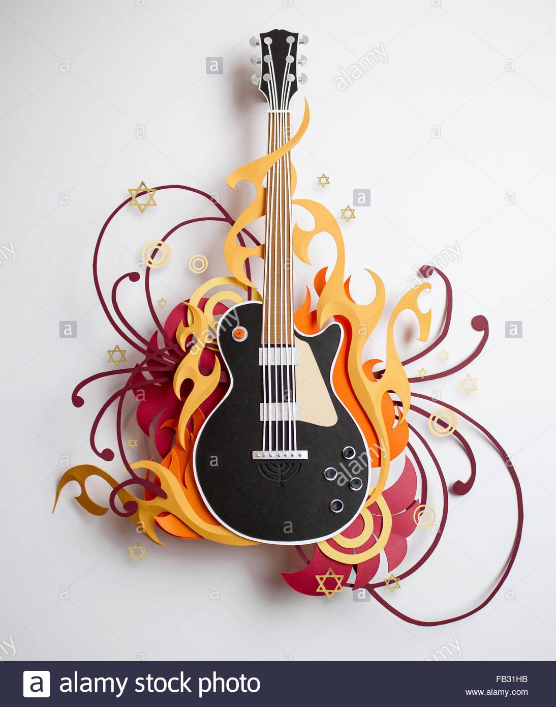 Stelle e volute che circonda carta artigianale chitarra Immagini Stock